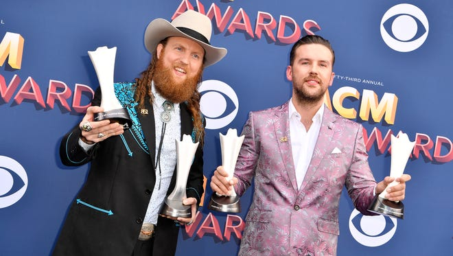 John Osborne, left, and T.J. Osborne of Brothers Osborne walk the red carpet for the 53rd Academy of Country Music Awards on Sunday, April 15, 2018, at the MGM Grand Garden Arena in Las Vegas. The two won trophies for Vocal Duo and Video of the Year.