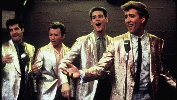 Nicolas Cage (far right) sings in 'Peggy Sue Got Married.'