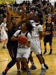 Alamogordo's Jerraysha Smith blocks Hobbs' Amaya Lewis. Hobbs defeated Alamogordo 36-33 Wednesday night.