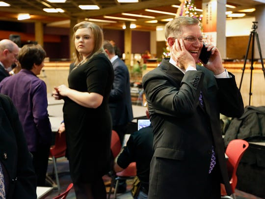 Mark Nook, an Iowa native and current chancellor of Montana State University Billings, takes a congratulatory phone call from former president Bill Ruud after Nook was announced as the 11th president of the University of Northern Iowa in Maucker Union Tuesday, Dec. 6, 2016, in Cedar Falls, Iowa. Nook will assume his new position on Feb. 1. (Matthew Putney/The Courier via AP)