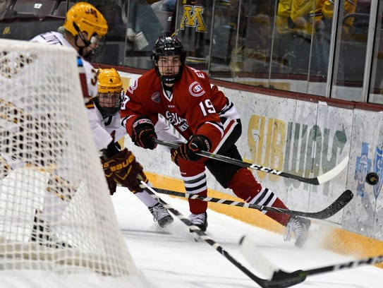 St. Cloud State's Mikey Eyssimont works a puck behind