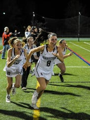 The Morristown girls lacrosse team celebrates after
