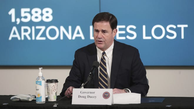 Arizona Gov. Doug Ducey updates reporters on COVID-19 in the state during a September news conference.