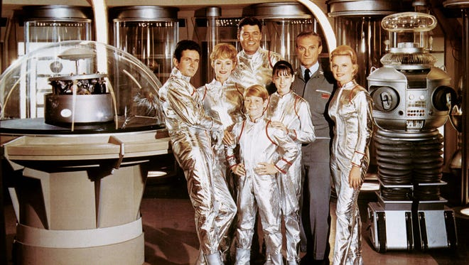 "The cast of the 1965 television program ""Lost in Space,"" left to right: Mark Goddard, June Lockhart, Billy Mumy, Guy Williams, Angela Cartwright, Jonathan Harris, Marta Kristen and The Robot."
