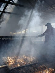 A crew of cooks will barbecue thousands of chicken halves on a 50-foot-long, 4-foot-wide barbecue grill during the Crane Broiler Fest. Chicken dinners are served Friday and Saturday.