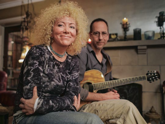 Indianapolis singer/songwriter Jennie DeVoe and guitarist Brett Lodde are shown in her house on Oct. 23, 2013.