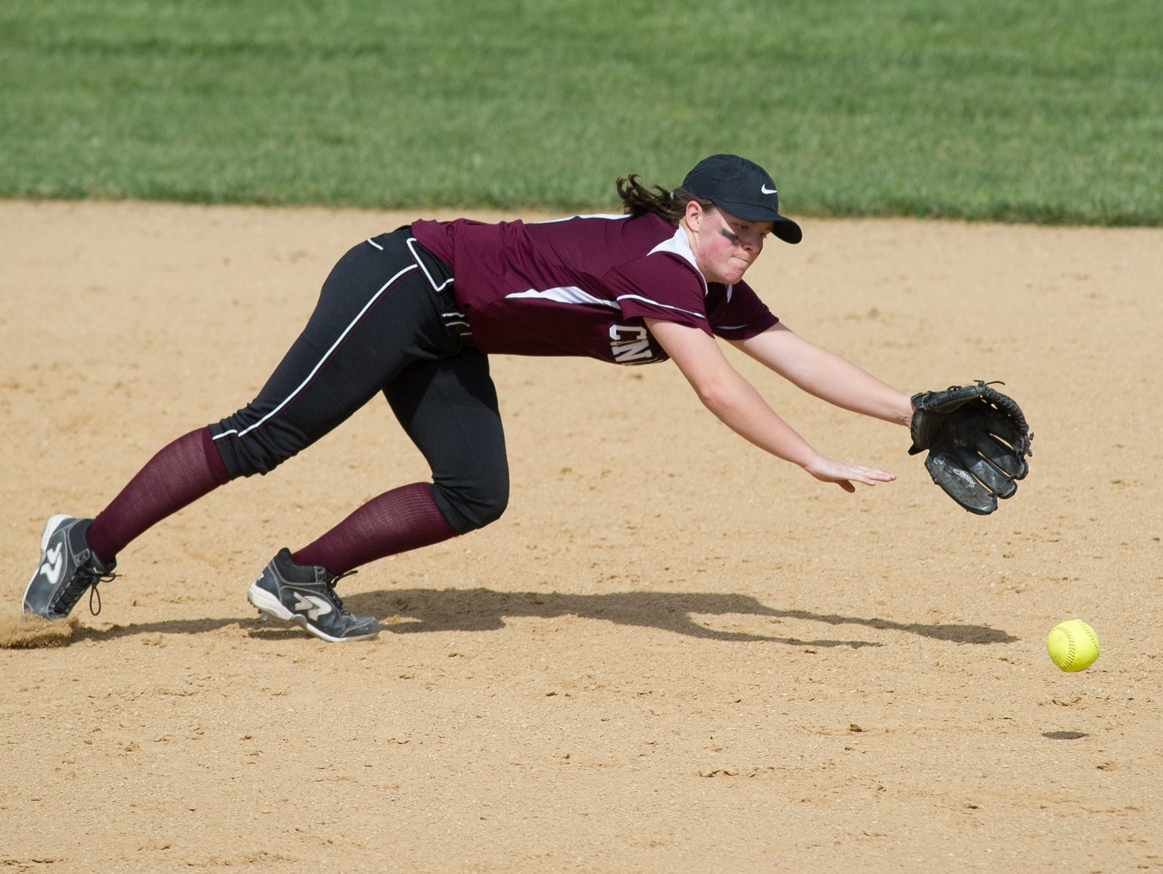 Concord's Eryn Bailey (8) dives for a ground ball in the second inning against Caesar Rodney.