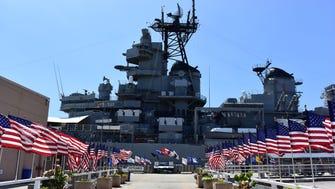 U.S. flags line the walkway to the USS Missouri.