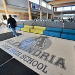 A custodian walks through the Aagard Commons at the heart of the new Alexandria Area High School on Feb. 6 in Alexandria. It features flexible seating areas and is centrally located to both the gymnasium and auditorium.