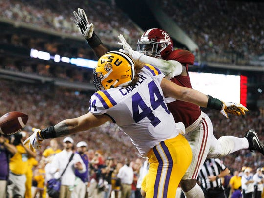 LSU fullback Tory Carter misses a pass as Alabama linebacker Shaun Dion Hamilton defends during the first half of an NCAA college football game, Saturday, Nov. 4, 2017, in Tuscaloosa, Ala. (AP Photo/Brynn Anderson)