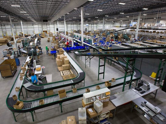 Workers fulfill online and mail orders in a 200,000-square-foot