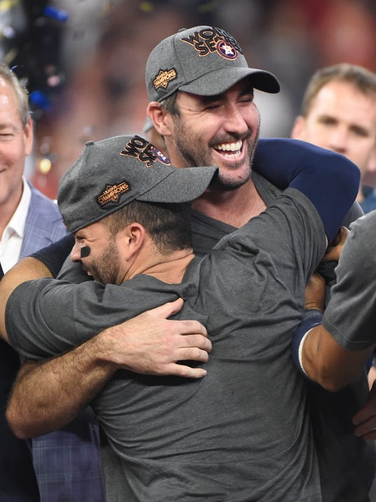 FILE - In this Oct. 21, 2017, file photo, Houston Astros' Justin Verlander hugs Jose Altuve after Game 7 of baseball's American League Championship Series against the New York Yankees in Houston. The Astros won 4-0 to win the series. Verlander and Altuve shared the Babe Ruth award as postseason MVP,  in awards voting by the New York chapter of the Baseball Writers' Association of America  (AP Photo/Eric Christian Smith, File)