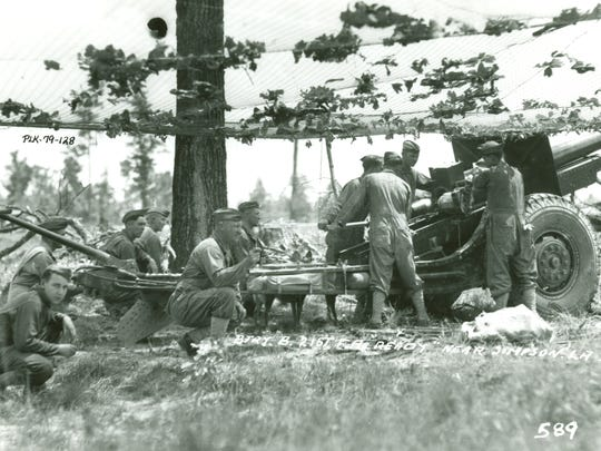 Battery B, 21st Field Artillery stands ready with its M1917 155mm Schneider Howitzer near Simpson during the Louisiana Maneuvers in 1941.