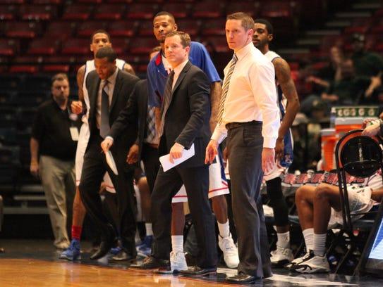 Louisiana Tech associate head coach Dusty May, center,