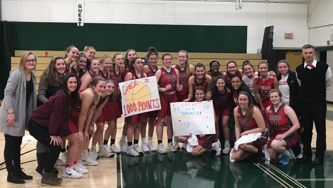 Grace Marshall, center, celebrates her 1,000th-career point with her Haddon Township High School team. The senior hit the milestone last Thursday.