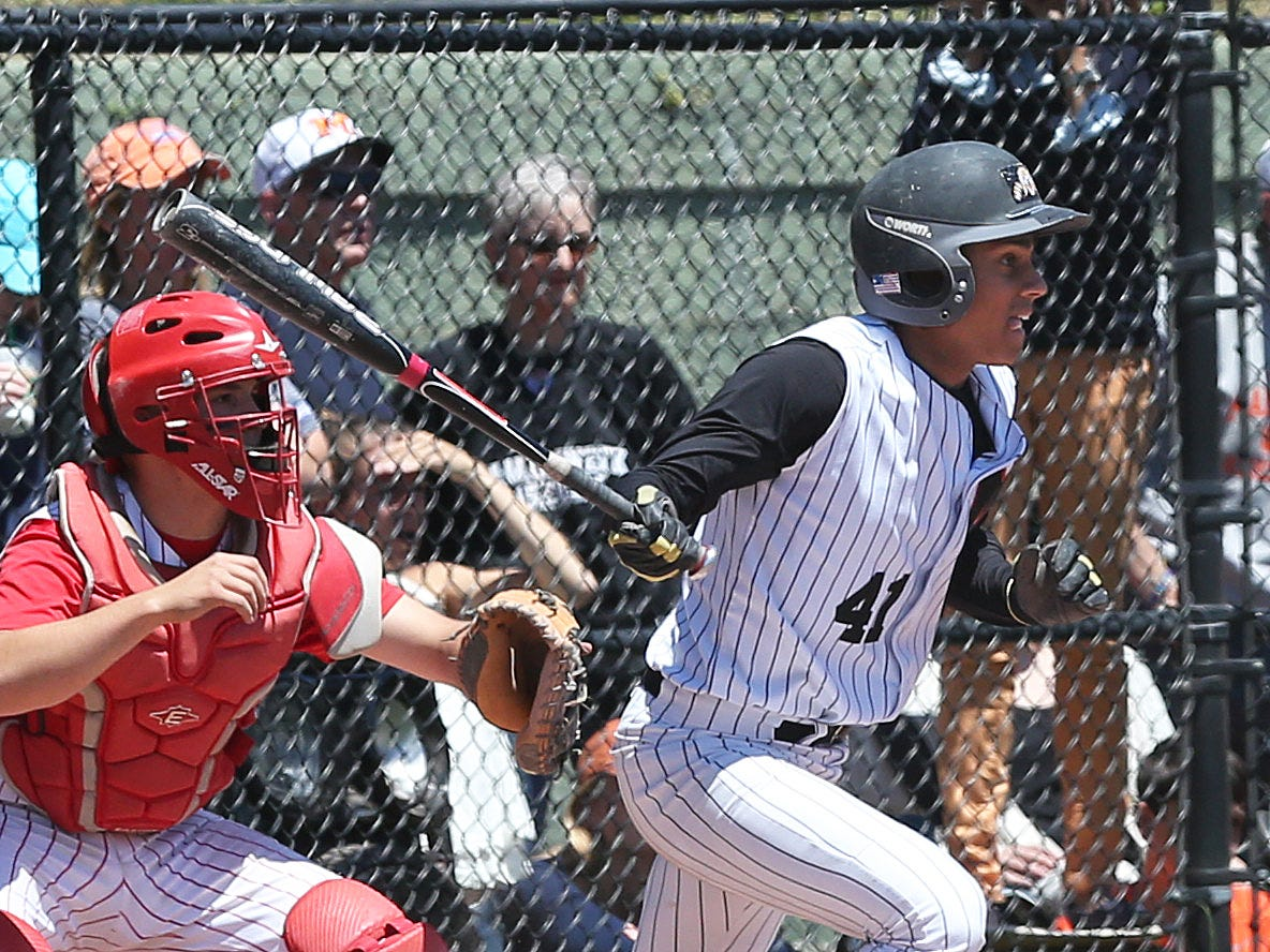 Mamaroneck's Kumar Nambiar hits a bases clearing double against North Rockland in a boys baseball playoff game at Mamaroneck High School on Saturday, May 23, 2015. Mamaroneck won the game 5-3.
