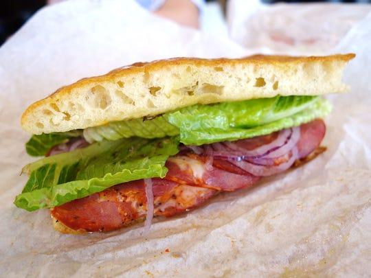 The #5 soppressata sandwich with ricotta, capicola, red onion, roasted red bell pepper, lettuce and vinaigrette at newly closed Leoni's Focaccia.