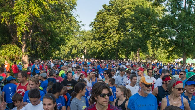 Runners await the start of the Firecracker 5K Citizen's Race at City Park Saturday, July 4, 2015. The 16th annual event hosted a run and walk for all skill levels, a children's race and an elite race for qualifying athletes.