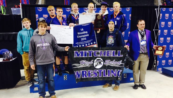 The Mitchell wrestling team and coach Ed Duncan.