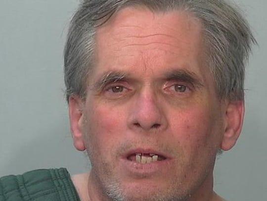 John D. Miller, 59, was arrested at his Grabill, Ind.,
