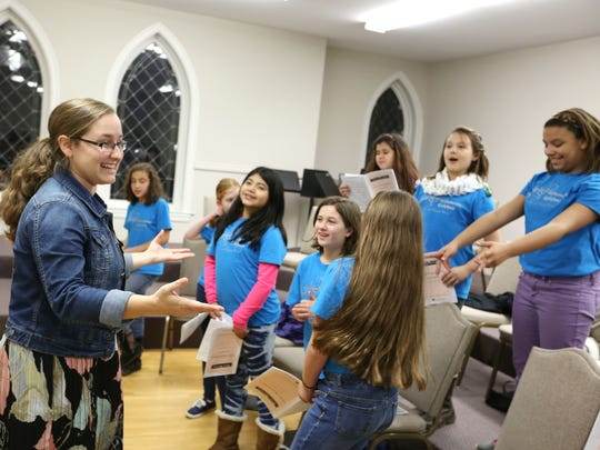 Julie Cherry instructs the Dolce choir of Willamette Girlchoir during rehearsal at First United Methodist Church in downtown Salem.