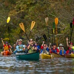 Boaters paddle their canoes and kayaks on the Bayou Teche in Breaux Bridge, La., Friday, Nov. 27, 2015. Pack & Paddle, a Lafayette outdoor equipment store, organized the paddle trip in 2014 to provide an alternative to Black Friday shopping.