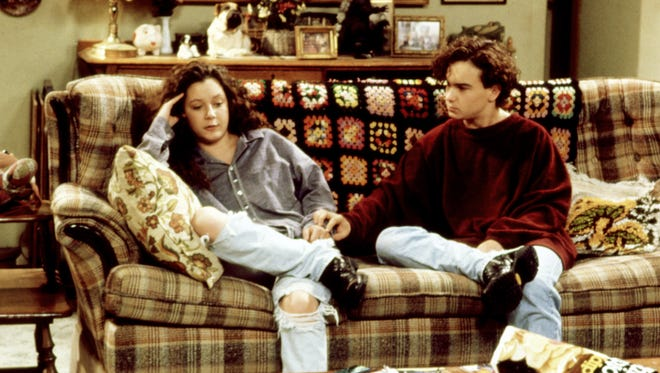 The relationship of Darlene (Sara Gilbert), left, and David (Johnny Galecki) goes back to 'Roseanne' in the 1990s, as seen here, and is featured in Tuesday's episode of ABC's 'Roseanne' spinoff, 'The Conners.'