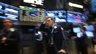 Traders work on the floor of the New York Stock Exchange on January 28, 2015.  (Photo by Spencer Platt/Getty Images)