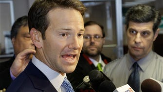 Rep. Aaron Schock speaks to reporters before meetings with constituents after a week in which he faced twin scandals on Feb. 6, 2015, in Peoria Ill.