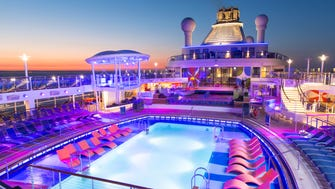 The pool deck of Royal Caribbean's Anthem of the Seas at sunset.
