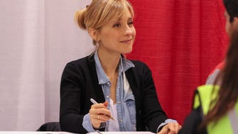 "Actress Allison Mack, form the television series ""Smallville,"" greets guests at the Suburban Collection Showplace in Novi on Saturday May 14, 2016 during the Motor City Comic Con."