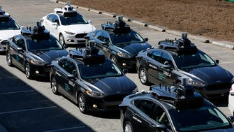 A group of self driving Uber vehicles position themselves to take journalists on rides during a media preview at Uber's Advanced Technologies Center in Pittsburgh