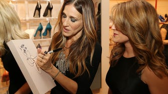 Sarah Jessica Parker signs an autograph for a shopper at the MGM National Harbor.
