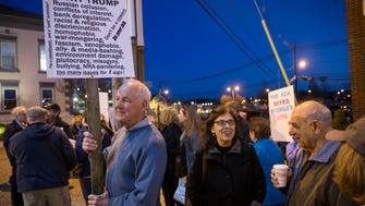 """Rich Wieland of Toms River protests with others. Protesters target Rep. Tom MacArthur upon his arrival to a call in radio show """"Ask the Congressman"""" which is broadcast from downtown Toms River. Toms River, NJThursday, February 23, 2017.@dhoodhood"""