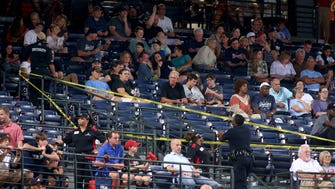 Turner Field security ropes off an area where fan Greg Murrey fell from the upper deck in the seventh inning of the game between the Braves and Yankees on Aug. 29, 2015.
