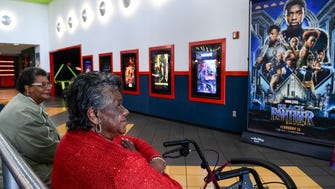 Janie Banks, left, and Mildred Johnson, right, wait for the noon showing of the Marvel Comics Black Panther movie at AmStar 14 in Anderson on Monday.