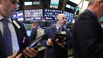 NEW YORK, NY - MARCH 21:  Traders work on the floor of the New York Stock Exchange (NYSE) after the Federal Reserve raised interest rates, a move that investors expected on March 21, 2018 in New York City. Stocks ended the day slightly lower with the Dow Jones Industrial Average down 44 points at the end of the day.  (Photo by Spencer Platt/Getty Images) ORG XMIT: 775144970 ORIG FILE ID: 935903534