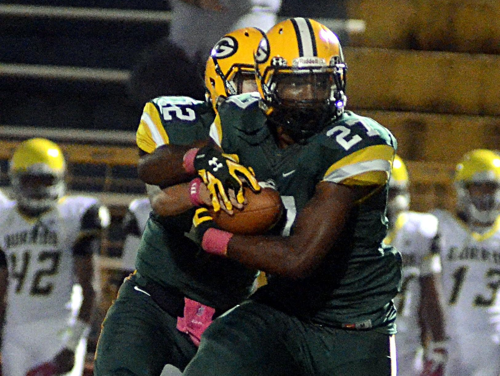 Gallatin High junior tailback Jordan Mason receives a handoff from quarterback Wyatt Hayes during first-quarter action. Mason rushed for 126 yards and a touchdown in the Green Wave's 28-13 loss to visiting Hillsboro.