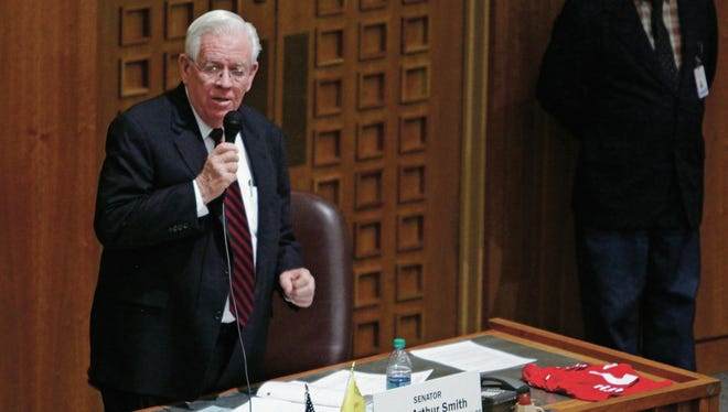 Sen. John Arthur Smith discusses his bill to reform the lottery scholarship Thursday.