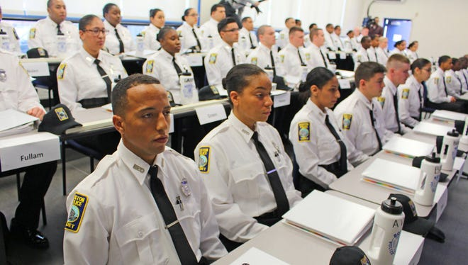 Police cadets prepare for a swearing-in ceremony at Boston's police academy on Nov. 16, 2016.
