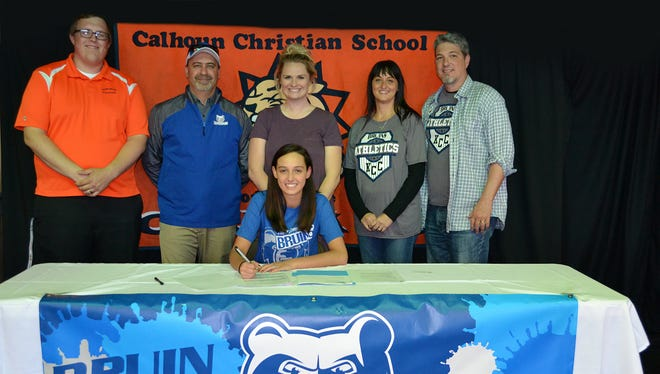 Calhoun Christian's Kirby Frodge (center) signs to play volleyball at Kellogg Community College.
