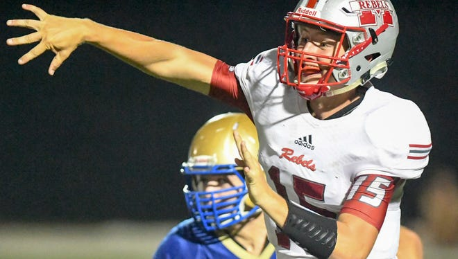 McKenzie's Zach Jarrett gets a pass off to his teammate during their game against Huntingdon, Friday, Aug. 18.