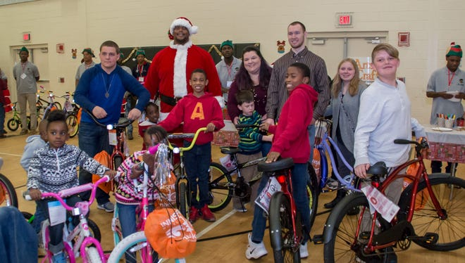 """Mr. Robbins' Neighborhood -- a non-profit organization started by NFL veteran Fred Robbins and his wife, Tia, to help mentor young kids -- hosts its second holiday breakfast party at the Marie K. Young Wedgewood Community Center on Saturday, December 16, 2017. Bikes donated by OnBikes Pensacola and the Escambia County Council PTA were given away during the event, which also featured a breakfast catered by Bistro 98, music by DJ Vaughn VanAmburg, portraits drawn by Carter J., photos with """"Fred Claus,"""" and arts and crafts stations for kids to enjoy."""