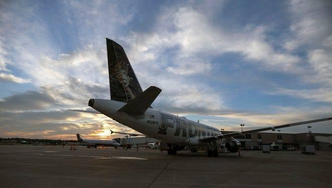 A commercial airline parks at a terminal at Des Moines International Airport.