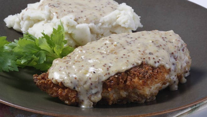 Lynn's Paradise Cafe's pecan-crusted chicken