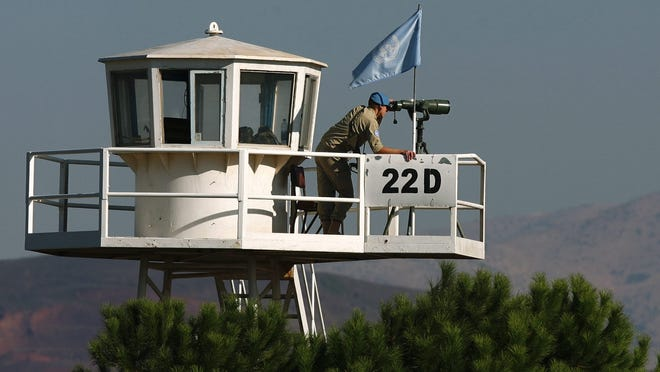This Sept. 24, 2009 photo shows U.N. soldiers watching the border between Israel and Syria, on the Golan Heights, near the Qunitra crossing border between the two countries.