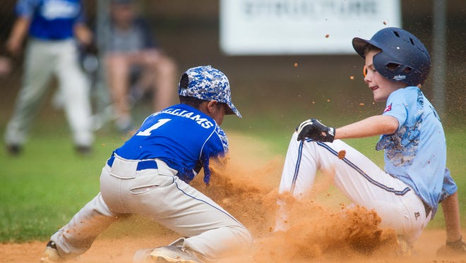 Will Wilkerson of Meridian Park All Stars slides safely into 2nd base after a double play during their game against Tallahassee's Capital Park All-Stars at Winthrop Park.