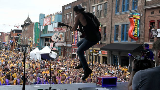 Kip Moore performs on Lower Broadway before Stanley Cup Final Game 4 on Monday, June 5, 2017, in Nashville.