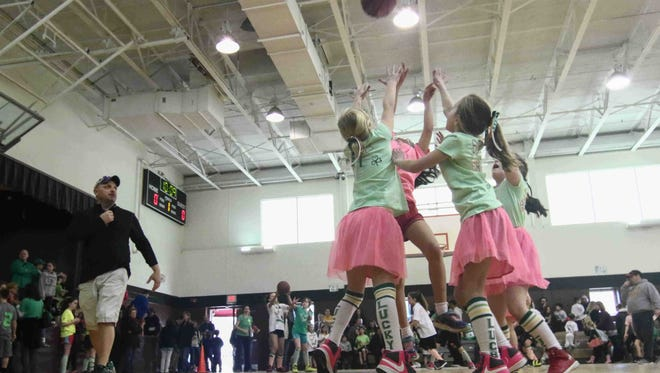 Irish Unicorns Guard's Rose Casey (62), Anna Harris (5) Jillian Hamberger (9) collapse to the ball in the first half of the 11th annual three versus three charity basketball tournament Saturday, Mar. 05, 2016. at St. Mary Magdalen School in Wilmington.