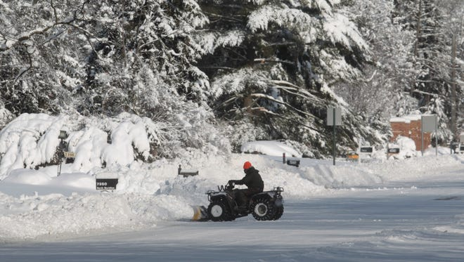Last year's big snow which dumped more than 11 inches of heavy, wet snow on Indianapolis, as shown in this photo from Jan. 6, 2014. Many are worried about farmers almanacs' predictions for another cold winter this year.